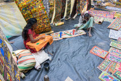 Handicrafts are perpared for sale by rural Indian man and woman in Pingla village, India Stock Photography