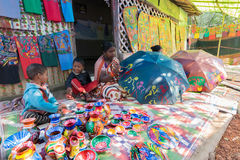 Handicrafts are perpared for sale by rural Indian woman with children. Stock Photos