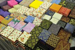 Handicrafts of Songket and Batik Boxes. Variety sizes of Handicrafts of Songket and Batik Boxes Royalty Free Stock Photos