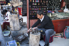 Handicraftsman in Dali ancient town Stock Photo