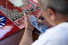 Handicraftsman drawing Royalty Free Stock Images