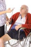 Handikapmann, der Notfall überprüft Stockbild