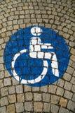 Handikappat - rörelsehindrat parkeringstecken 64 Royaltyfri Foto
