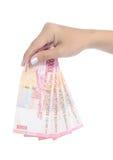 handindonesia pengar över något Royaltyfri Bild
