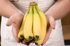 Handing banana Stock Photography
