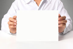 Handing a blank business a4 card over Royalty Free Stock Image