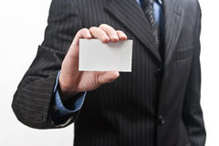 Handing a blank business card Stock Image