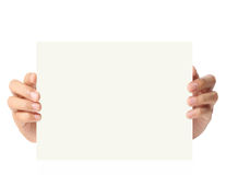 Handing blank business a4 card over in hand Royalty Free Stock Photos