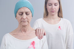 Handing breast cancer down from generation to generation. Older mother and her young daughter suffering from breast cancer Royalty Free Stock Photography