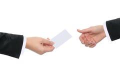 Handing a card Stock Photo
