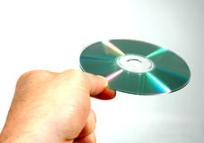 Handing CD. 1 Royalty Free Stock Image