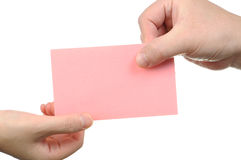 Handing empty pink business card Royalty Free Stock Images