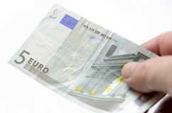 Handing five dollar euro bill Stock Photography