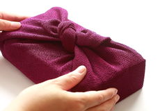 Handing Gift with Japanese wrapping cloth Furoshiki, Japanese culture Royalty Free Stock Image