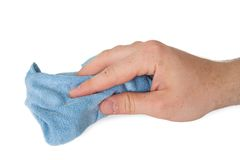 Handing hold blue dirty cloth rag wiping cleaning. Man cleaning with a blue rag Stock Photography