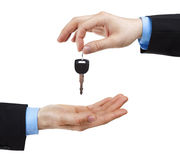 Handing a key. Two human hands exchanging a key isolated on white Stock Images
