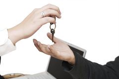 Handing keys Stock Image