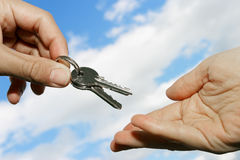Handing Keys Royalty Free Stock Photo