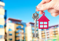 Handing keys in the house background. Closeup stock image
