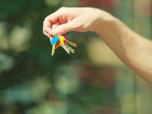 Handing keys in the house background Royalty Free Stock Image