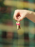 Handing keys in the house background Stock Images