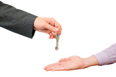 Handing of keys from one man to other Stock Photo