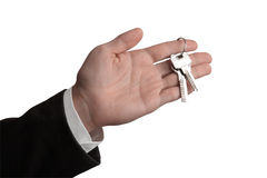 Handing the keys over. The metallic keys lying on the palm of a man's hand; isolated on white background stock illustration