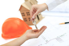 Handing keys. To the future home Stock Photography