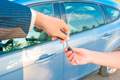 Handing the keys to a new car customer Royalty Free Stock Photos