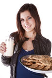Handing milk and cookies Stock Photos