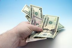 Handing money. Hand giveing money royalty free stock photos