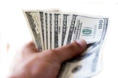 Handing Money royalty free stock photo