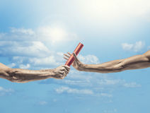 Handing off the baton in a track and field event Royalty Free Stock Photo