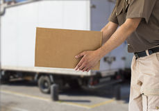 Handing out cardboard box Royalty Free Stock Image