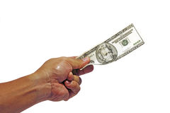 Handing out dollars. An image showing a hand handing out a US dollar note stock image