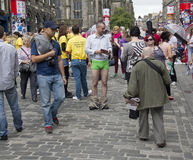 Handing out Flyers at the Edinburgh Festival. EDINBURGH: AUGUST 2: Unidentified boy with his pants down hands out flyers on the Edinburgh Festival Fringe on Royalty Free Stock Images