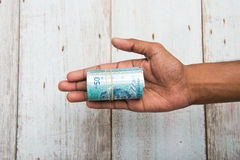 Handing out money in Malaysia ringgit Stock Images