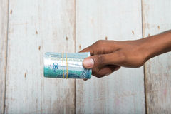 Handing out money in Malaysia ringgit Royalty Free Stock Photography