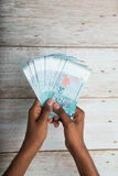 Handing out money in Malaysia ringgit Stock Photos