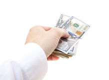 Handing out pile of dollar notes Royalty Free Stock Image