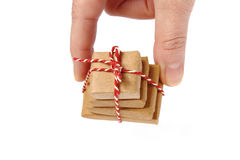 Handing out a pile of sweet christmas gifts Stock Image