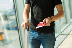 Handing over boarding pass and passport to embark Royalty Free Stock Images