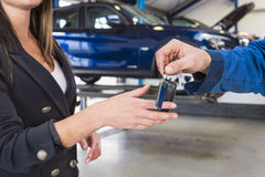 Handing over carkeys after repair Stock Photos