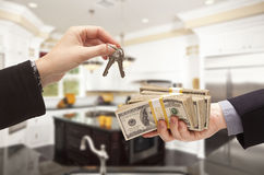 Handing Over Cash for Keys Inside Beautiful Home Stock Image
