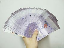 Finance Currency handing over money malaysia royalty free stock image