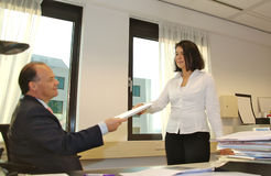 Handing over documents Stock Images