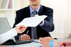Handing over documents. Close-up of handing over documents during business briefing royalty free stock photos