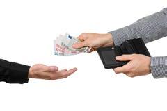 Handing over Euro banknotes. Royalty Free Stock Photos