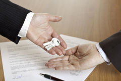 Handing over of house keys Royalty Free Stock Image