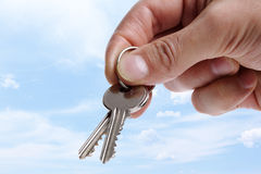 Handing over house keys Royalty Free Stock Photo
